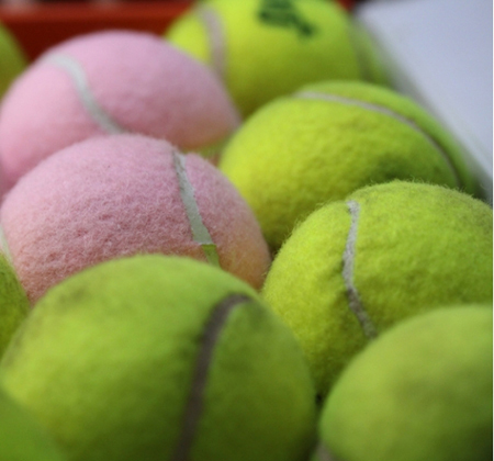 pink and green tennis balls